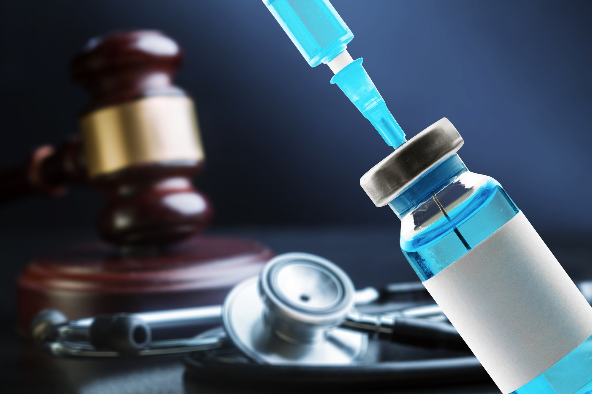 Vaccine and gavel. Covid shot and courthouse